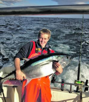 Kieran Gilbert on board Moonshine with a good-size schoolie bluefin
