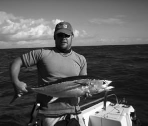 The author with a longtail tuna taken on a ballyhoo soft plastic.