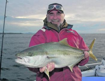 John Scatchard has that grin that comes from catching a good Tasmanian Kingfish