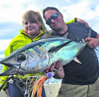 A secret squid jig does the trick for these two big game anglers.