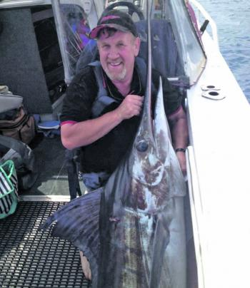 Craig Shipton with his marlin captured of St Helens.