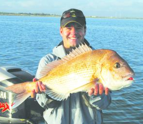 "Bill Hartshorne with a large snapper taken from the spoil ground near Point Henry on a Berkley Gulp 4"" Minnow in nuclear chicken."