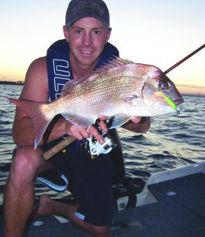 "Brent Hodges with a pinkie snapper taken on a Berkley Gulp 3"" Minnow Grub in mango ripple glow."
