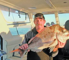 As the sun sets on another June glass-out, the snapper come out to play. Carl with a bumpy headed little snapper.