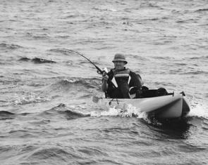 Rob Paxevanos fighting a yellowfin tuna at the Drumstick Canyons from his Hobie kayak.