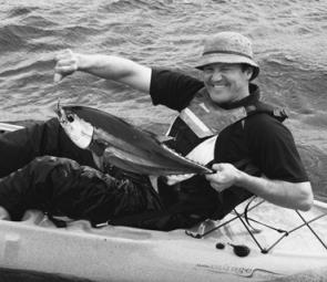 Rob with a 6kg yellowfin he caught from his kayak at the Jervis Bay Canyons on a pilchard cube.