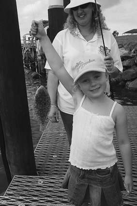 It's time for all the family to get out and enjoy themselves on the water. This young lady was more than happy with a flounder from Huskisson wharf.