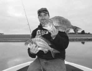 Stewie McKinnon with two quality Hopkins River bream, the largest of which measured 43cm to the fork. Bream should start to disperse throughout the estuary system as the water warms in October.