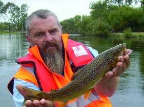 Paul Wallis of Alexandra with a brown trout. With the decreasing water temperatures, the trout fishing around Eildon should fire up in May.