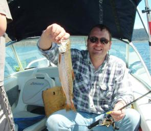 Bill Wales with a brown trout from Lake Dartmouth, which is fishing well despite the falling water levels.