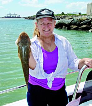 Sylvia Robertson with a nice flathead that was caught around the Townsville rock walls. When it is too windy to head offshore, fish like this still make it worthwhile putting the boat in.