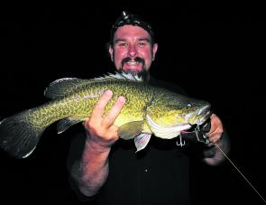A lovely coloured Murray cod caught in the Ovens River after dark on a Koolabung Codwalker surface lure.