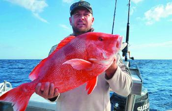 Damian Hickey got this brace of reds from the deep water bommies around Fitzroy.