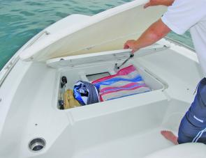An insulated storage area is mounted right up front, the bow cushion lifts to access it.