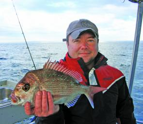 Mark Dempsey with a smaller snapper caught on a soft plastic off Long Reef.