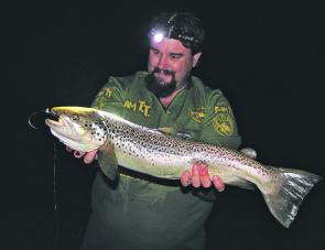 The author's personal best trout. A lovely 68cm brown trout which fell to the Strike Tiger nymph soft plastic after dark in the Kiewa River near Redbank.