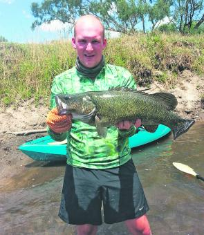 Brenton Richardson with a lovely dark 70cm Murray cod from the Kiewa River.
