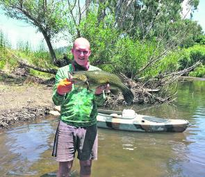 Brenton Richardson with a lovely Kiewa River Murray cod caught during the summer heatwave.