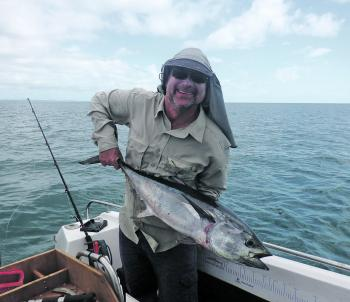 Brett Whaley with a longtail tuna. April is the month these fish shine off Hervey Bay.