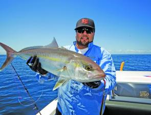 Juan Bran with an amberjack caught on a recent jigging trip.