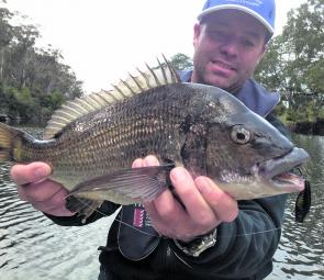 Grant Stingel with a Scamander bream, typical of the fish being caught at the moment.