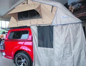 An ARB roof top touring tent sets up in less than two minutes to make camping a breeze.