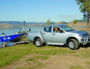 The powerful Triton GL-R diesel made easy work of towing the author's 4.2m TABS Bullshark to Somerset Dam for a crack at the bass. The nudge bar and alloy wheels are standard with the GL-R.