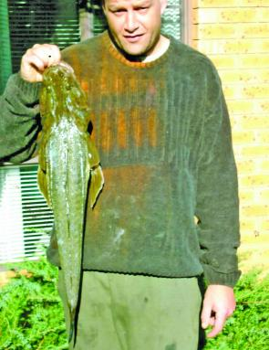 Aaron Myers with one of many flathead he's caught in Narrabeen Lake.