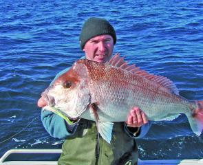 Craig Bell with more than 8kg of deep-water, plastic-caught snapper.