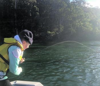 Sophie Hindson hooked up to a rampaging salmon in Pambula Lake.