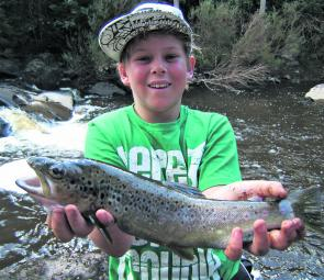 Ben Sherriff with a worm caught Supply Brown Trout.