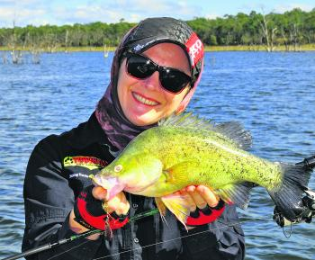 Jo Starling with a small golden perch that was only very lightly pinned, thanks to the use of 'sticky sharp' hooks on her lure.