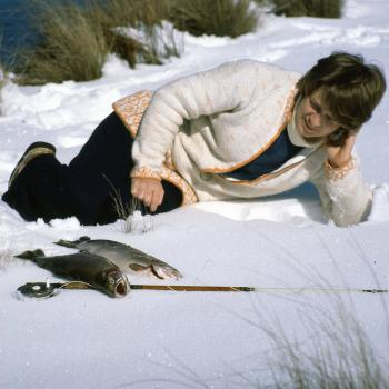 Doris Pratt enjoying a break in the snow with a couple of nice fish for the table.