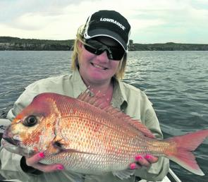 Tracey Wright caught this healthy red from JB on a plastic.