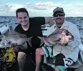 Chris Neville and Jarrod Humfrey with a pair of wash-caught reds.