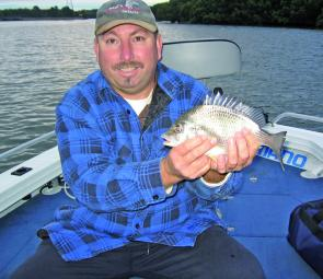 Brian Rhodin with an early morning bream. In August the author usually prefers to get up a bit later in the morning and still scores his share.