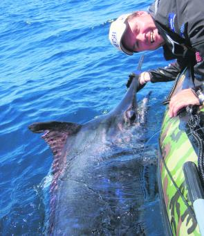 Paul Worsteling with a black marlin estimated at 150kg, caught and released from a 3m inflatable boat.