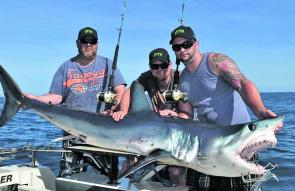 Brendan Wing, Dave Standing and the YouFish crew display the fruits of a hard day's berleying – a quality mako that went 105kg.