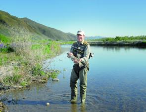 The Snowbee 210 denier waders assisted the author in taking this fat trout from New Zealand's Tekapo River in cold conditions.