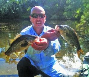 Bic Fox with two bass from the Georges River.