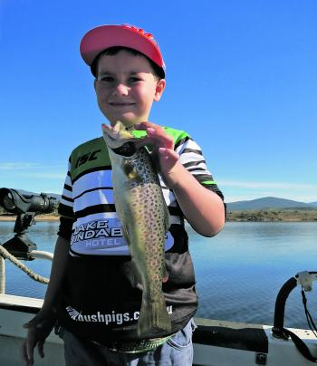 Lauchie Maloney, eight years old, with a lovely winter trout.