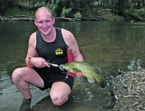 Brenton Richardson with a lovely coloured small Murray cod caught in clear water on a Mudguts spinnerbait.