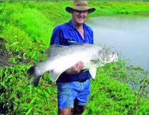 Graham Hansen with a fine barra taken from the small pool in the background.