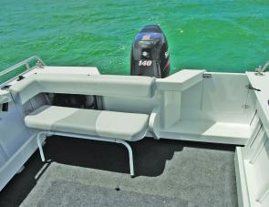 The Seahawk's wide transom area features a removable three person seat.