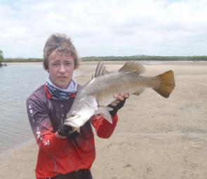CQ Fishing and Boating Facebook team member Connor with a freshly tagged barra.