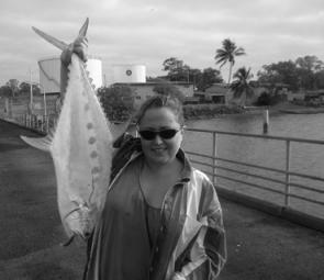 Jasmine Jones with a small lure caught queenfish.
