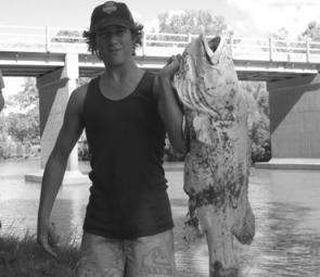 Local Karl Ware holding onto a 20kg cod that was killed by the recent downpour.