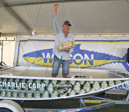 Catching a carp never felt so good for Bruce Woodfall as he celebrates winning a boat package.