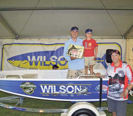 Junior lucky door boat package winner Christopher Sviler and his father could not have been happier with their win.