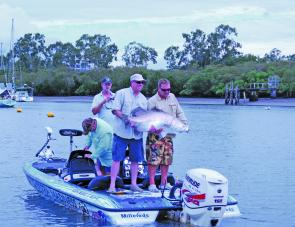 Jason Wilhelm and crew crack a 126cm barra from the Boyne River despite the tough fishing.